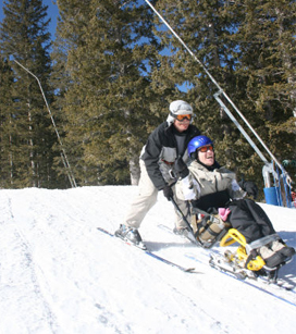 teacher helping a student ski