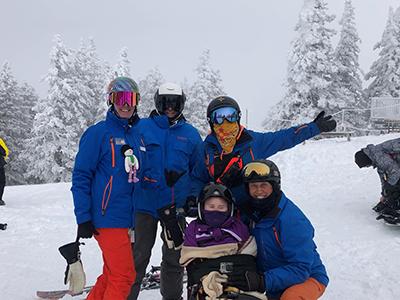 Makenzie and family skiing