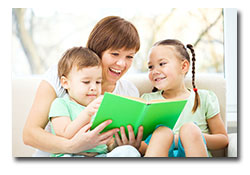 Happy mom with children reading a book