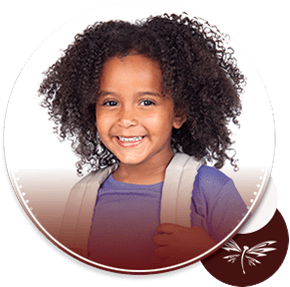 elementary student holding on to backpack