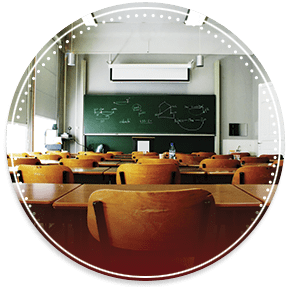 empty classroom with desks and chalkboard