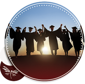 graduation students at sunset