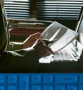 Closeup of hands using a computer