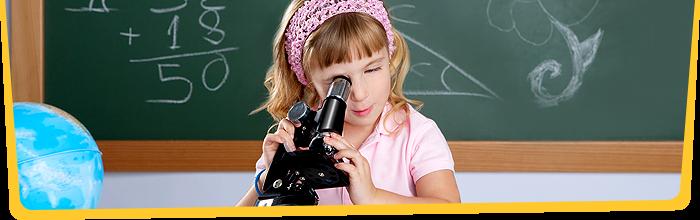 Girl looking in microscope