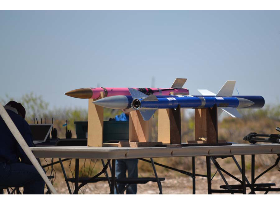 Pink and blue rockets on a table