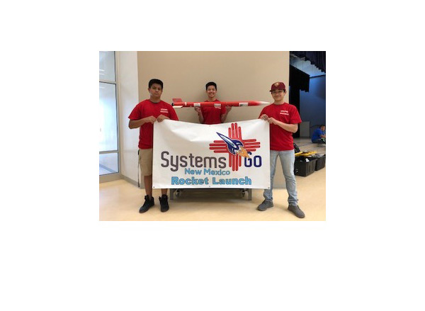 Students in red shirts with Systems Go New Mexico sign