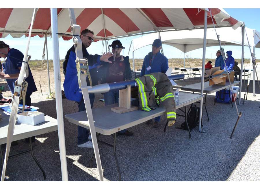 Fireman jacket laid across rocket at outside table