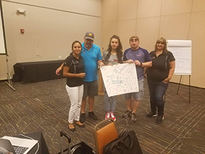 Jazmin Pando, Steven Goluska and other Pecos Valley REC 8 members pose together