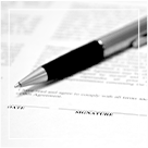 pen sitting on legal document