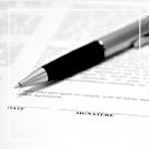 pen sitting on legal document