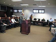 Apache citizen speaking at the podium