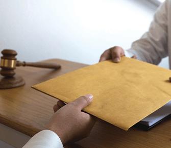 Court member handing over a big envelope
