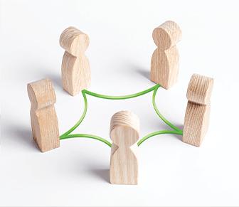 wooden blocks shaped like people in a network