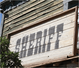 Sheriff sign made of wood on a building