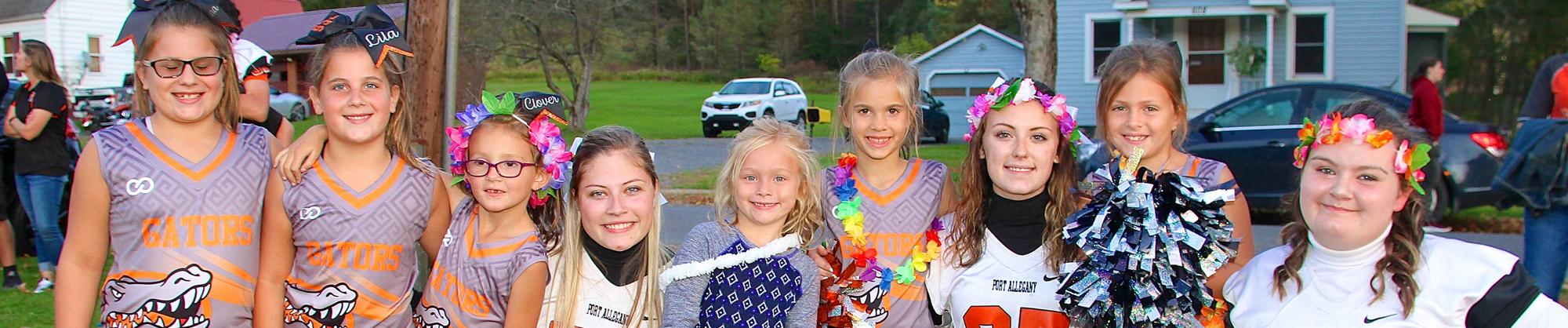 group of elementary and high school cheerleaders