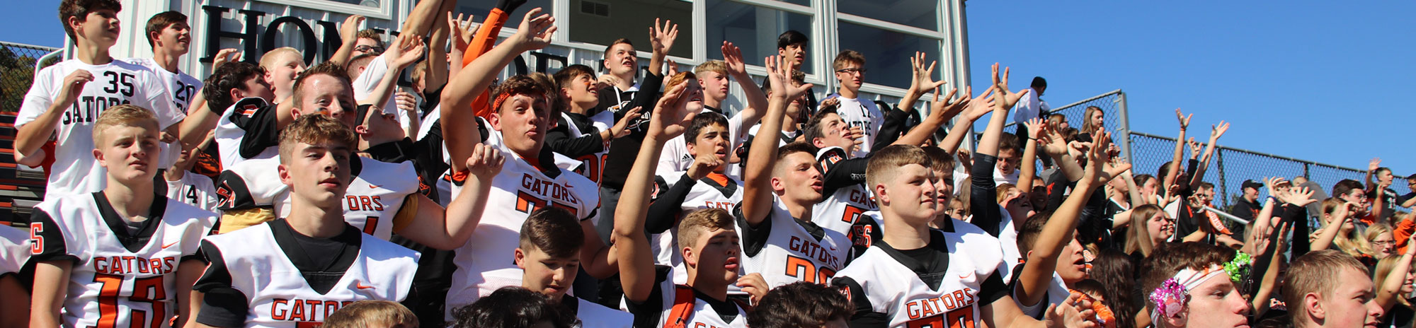 Port Allegany football players cheering in the stands