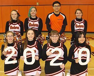 eight cheerleaders holding the numbers 2020