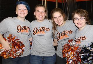 four girls wearing t-shirts that say Gators