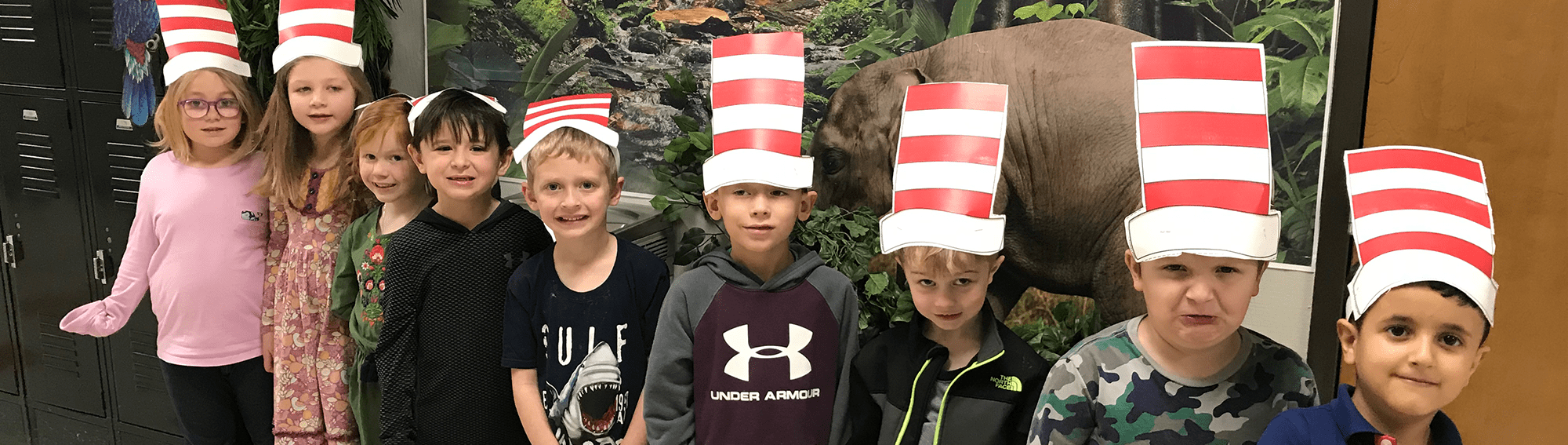 Students wearing paper cut outs of the cat's hat from The Cat in the Hat posing together