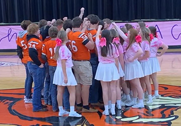 Students huddling together during a pep rally