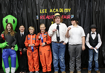 Students posing with ribbons from the Lee Academy Reading Fair