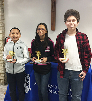 Three proud students with their Spelling Bee awards