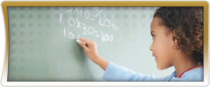 Female student writing math equations on a chalkboard