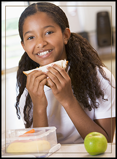 Female student eating a sandwich