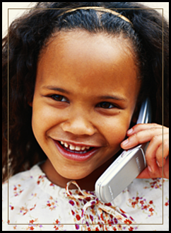 Smiling female student using a cell phone