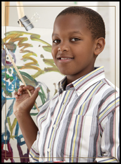 Male student painting with a paintbrush