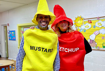 group of students looking at a fire truck