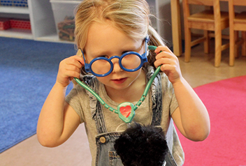 little girl listening to her teddy bears with a stethoscope