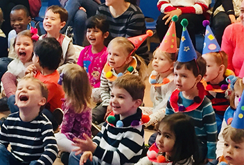 group of kids wearing party hats