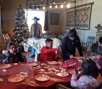 students sitting at a table at Christmas time