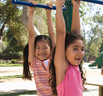 two girls on a playground