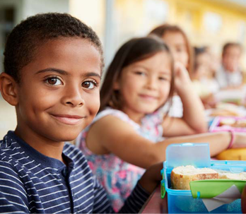 students eating lunches