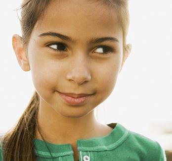 hispanic girl in green shirt