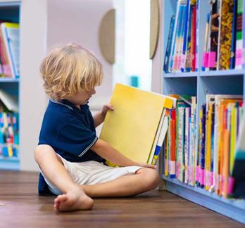 little boy in library
