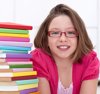 girl with a stack of books