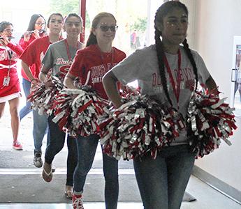 Group of cheerleaders walking into school
