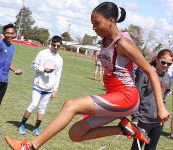 Janeya jumping during a track meet