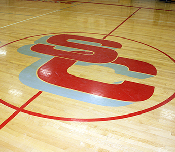 School basketball court with SC painted on the court
