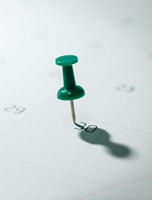 Pushpin stuck in the 30th date of a calendar