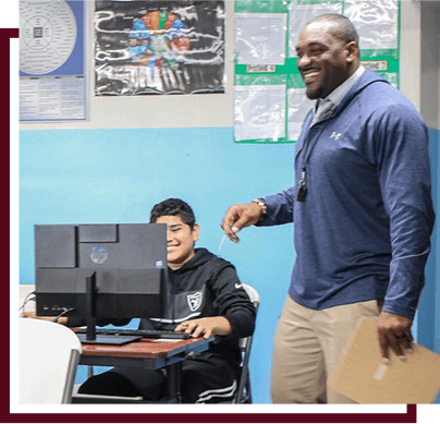teacher smiling while giving instruction