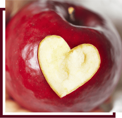 apple with a heart bite