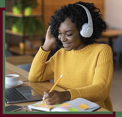 girl with headphones working on school work