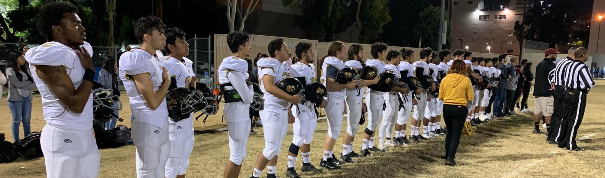 University Park football team with hands over hearts