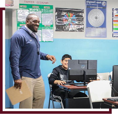 High school teacher in the computer lab with students