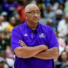 George Gervin coaching a game
