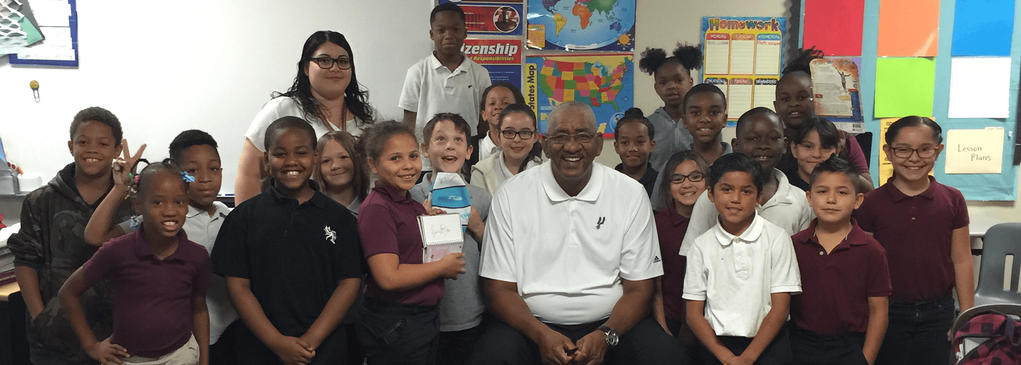 Group of students posing with George Gervin